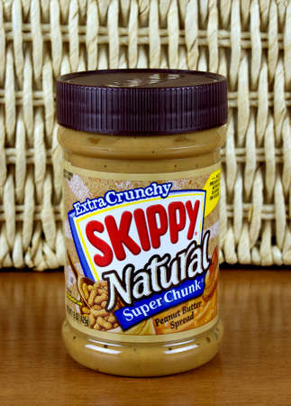 RIVER FALLS,WISCONSIN-MARCH 21,2016: A jar of Skippy brand extra crunchy peanut butter. Skippy is a product of Hormel Foods LLC.