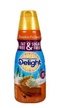 creamer: RIVER FALLS,WISCONSIN-APRIL 24,2016: A container of International Delight brand Pumpkin Pie Spice coffee creamer.