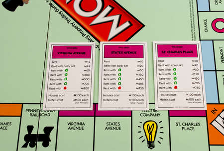 monopolio: RIVER FALLS,WISCONSIN-JANUARY 30,2016: A closeup view of a Monopoly board featuring Virginia and States avenues and Saint Charles Place.