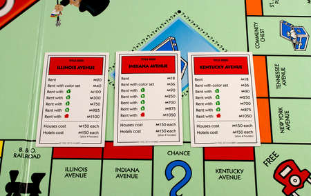 deed: RIVER FALLS,WISCONSIN-JANUARY 13,2016: A closeup view of a Monopoly board featuring Illinois,Indiana,and Kentucky avenues.