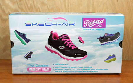 shoe box: RIVER FALLS,WISCONSIN-SEPTEMBER 05,2016: A Skechers brand shoe box against a wood background.