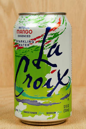 RIVER FALLS,WISCONSIN-SEPTEMBER 10,2016: A can of La Croix brand Mango flavored sparkling water against a wood background.