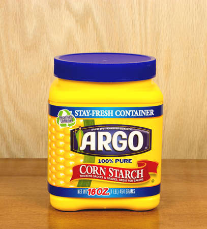 starch: RIVER FALLS,WISCONSIN-SEPTEMBER 21,2016: A container of Argo brand corn starch against a wood background.