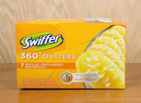 refills: RIVER FALLS,WISCONSIN-SEPTEMBER 25,2016: A box of Swiffer brand dusting pads with a wood background. Editorial