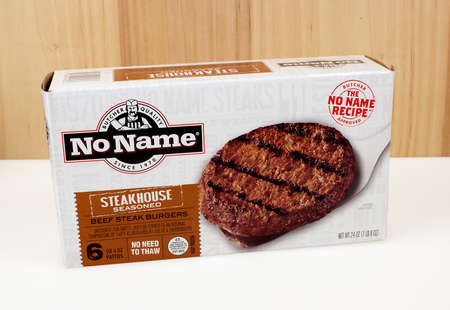no name: RIVER FALLS,WISCONSIN-DECEMBER 19,2016: A box of No Name brand beef steak burgers with a wood background.
