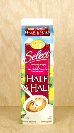 RIVER FALLS,WISCONSIN-FEBRUARY 23,2017: A carton of Kemps brand Half and Half with a wood background.