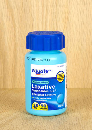 RIVER FALLS,WISCONSIN-MARCH 09,2017: A bottle of Equate brand stimulant laxative with a wood backgrund