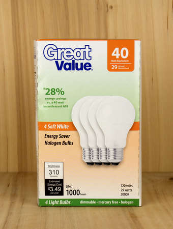 RIVER FALLS,WISCONSIN-APRIL 21,2017: A pack of Great Value brand forty watt light bulbs against a wood background. Editorial