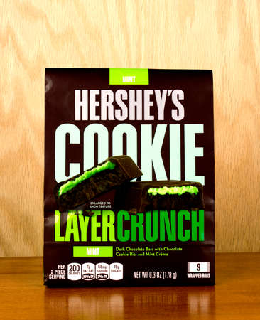 hershey's: RIVER FALLS,WISCONSIN-APRIL 25,2017: A bag of Hersheys brand layer crunch cookie bars with a wood background.