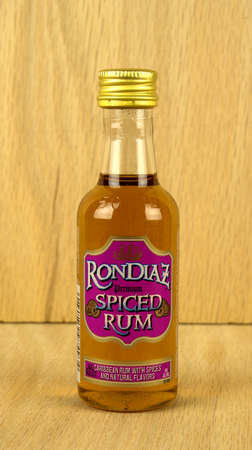 RIVER FALLS,WISCONSIN-JULY 02,2017: A bottle of Rondiaz brand spiced rum with a wood background.