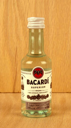 superiors: RIVER FALLS,WISCONSIN-JULY 04,2017: A bottle of Bacardi brand rum with a wood background.