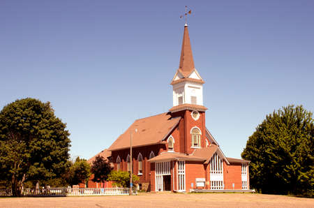A vintage rural church on a sunny Spring day.