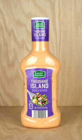 RIVER FALLS,WISCONSIN-SEPTEMBER 22,2017: A bottle of Tuscan Garden brand Thousand Island dressing with a wood background.