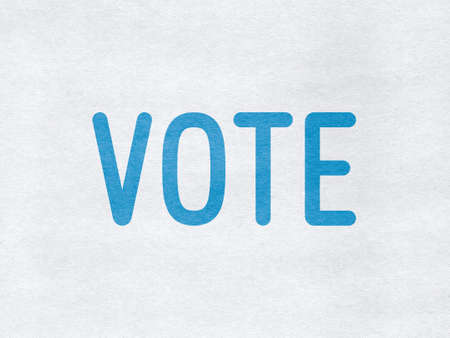 Vote - word on paper background
