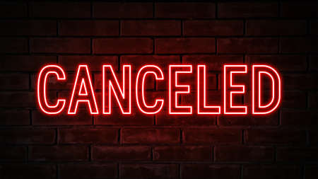 Canceled - red neon light word on brick wall background