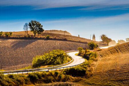 Winding road on hills in Crete Senesi Tuscany photo