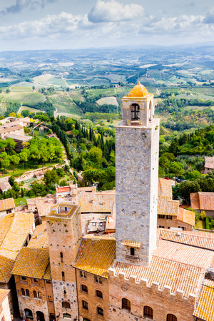 medioeval: San Gimignano is a small walled medieval hill town in the province of Siena, Tuscany, Italy. Known as the Town of Fine Towers Stock Photo