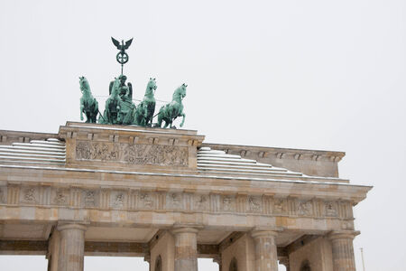 The Brandenburg Gate (German: Brandenburger Tor) is a former city gate, rebuilt in the late 18th century as a neoclassical triumphal arch, and now one of the most well-known landmarks of Germany. photo