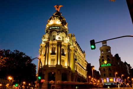 via: Madrid, Spain - July 29, 2010: The Metropolis building and Gran Via at sunset