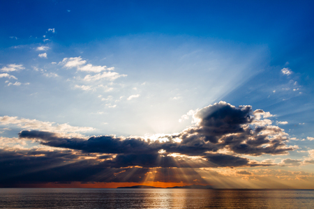 misterious: Crepuscular rays on Follonica gulf in Tuscany, Italy