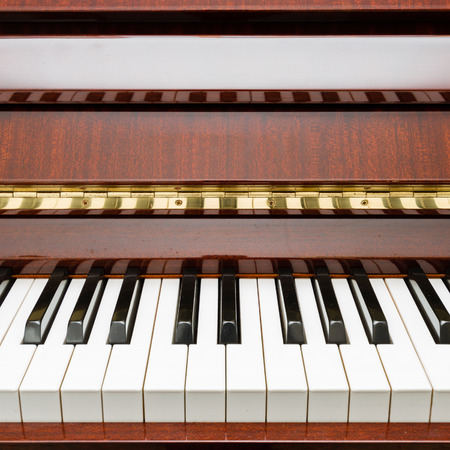 melodic: Modern rosewood acoustic piano Stock Photo