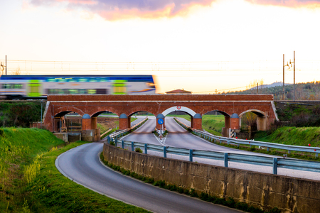 Railway bridge over road in Tuscany, Italy Stock Photo
