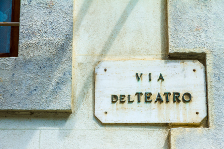 street signs: Via del teatro means Theater road in Italian. Road sign in Montepulciano, Tuscany