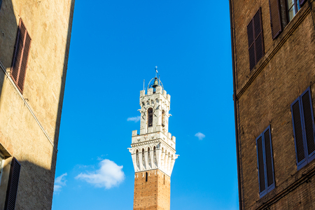 The Torre del Mangia is a tower in Siena, in the Tuscany region of Italy Stock Photo