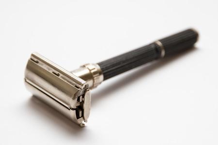 chrome man: Traditional double edge safety razor isolated on white background