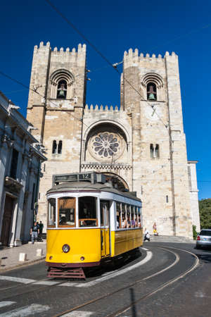 Lisbon Cathedral in summer with tramway