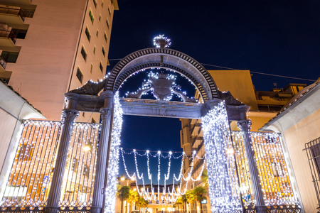 Old 1840s Gate of the former ILVA Ironworks Complex in Follonica at Christmas time Stock Photo