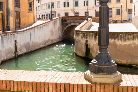 The Venezia Nuova in district in Leghorn, Italy,  shows bridges, narrow lanes and a dense network of canals