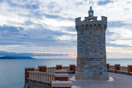 The Rocchetta Lighthause in Bovio square, Piombino, Italy, at sunset