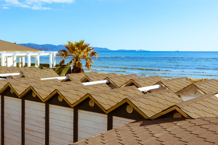 Follonica, Italy. Top view of Bathing huts in a spring sunny afternoon