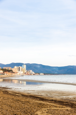 Follonica (GR), Tuscany, Italy. The town seen from the shore in a clear winter day