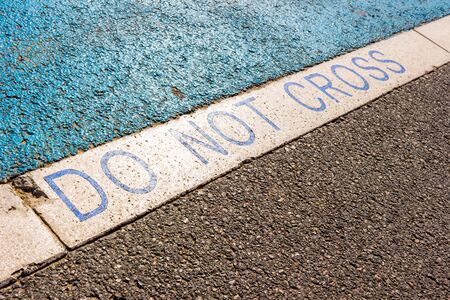 Follonica (GR), Italy - Do not cross sign near a cicle path in a sunny day in late spring Stock fotó