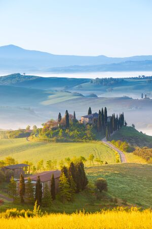 Siena, Italy - May 02, 2019: an iconic landscape in Orcia valley, Tuscany, in spring at sunrise.