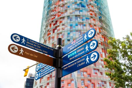 Barcelona, Spain - September 05, 2018: The Torre Glories, formerly known as Torre Agbar and some street signs in Barcelona, Spain