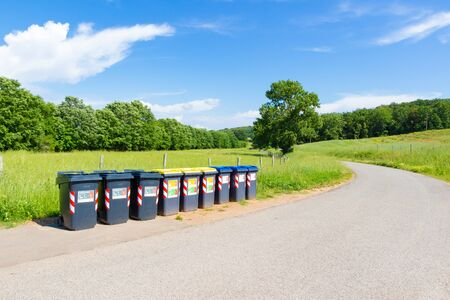 Grosseto, Italy - May 23, 2019: Separate collection of household waste in action in the beautiful tuscan countryside Sajtókép