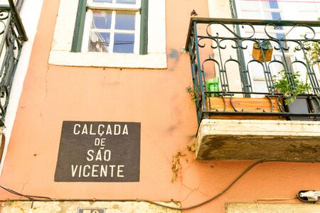 Lisbon, Portugal - July 17, 2014: Typical windows and balconies in the old Alfama district, Lisbon, Portugal