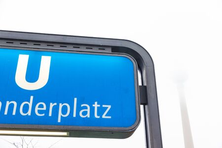 Berlin, Germany - December 21, 2017. Alexanderplatz subway station sign in winter in a foggy day
