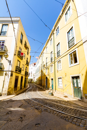 Tramway rails and streets in the historic center of Lisbon, Portugal Editorial