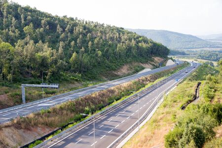 View from the junction for Iesa of the Grosseto - Siena freeway, Italy in late afternoon in summer 版權商用圖片