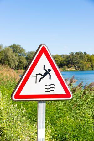Fall hazard sign near the Rhone river in Avignon, France