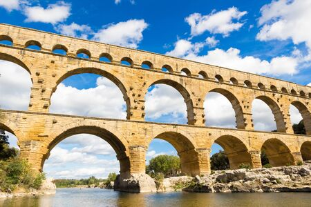 The Pont du Gard is an ancient Roman aqueduct in southern France Stock fotó - 132033619