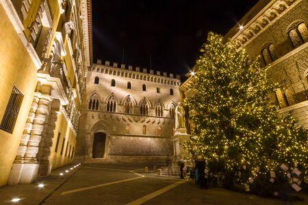 Siena, Italy - December 08, 2015:  Palazzo Salimbeni, headquarters of the Monte dei Paschi di Siena bank at Christmas time
