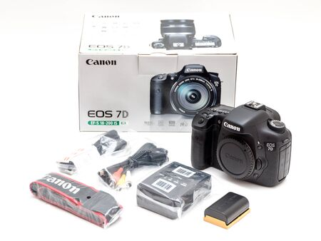 Rome, Italy - March 06, 2019: Canon 7D dslr camera with accessories still life Sajtókép