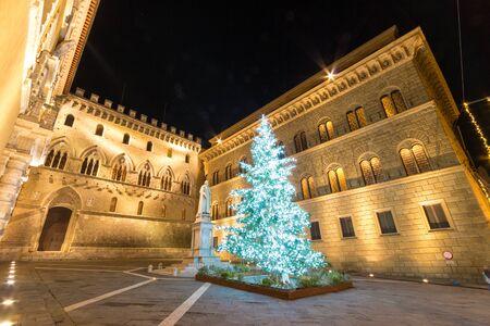 Siena, Italy - December 08, 2019:  Palazzo Salimbeni, headquarters of the Monte dei Paschi di Siena bank at Christmas time