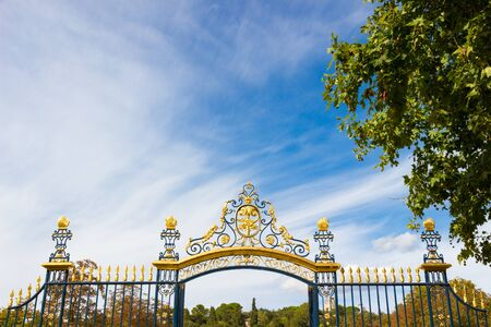 Entrance gate of the Fountain gardens (fountain gardens) of Nimes in southern France