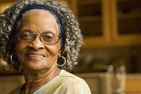 ancianos felices: Happy elderly African American woman at her house.